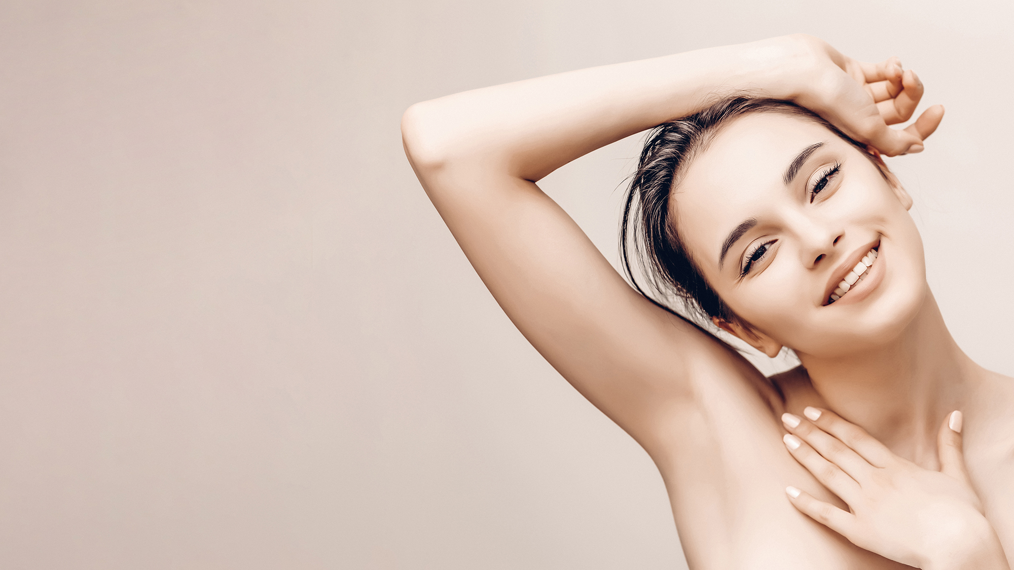 Natural beauty portrait of female face and body with silky smooth, hair-free skin.